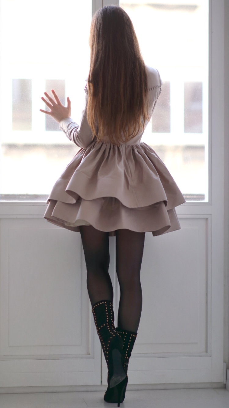Black blazer is worn atop white dress in black stripes completed with classic tights and over-the-knee black socks tucked in black pumps: Cream-beige sweater is worn with black shorts and patterned black tights tucked in black leather Oxfords shoes.