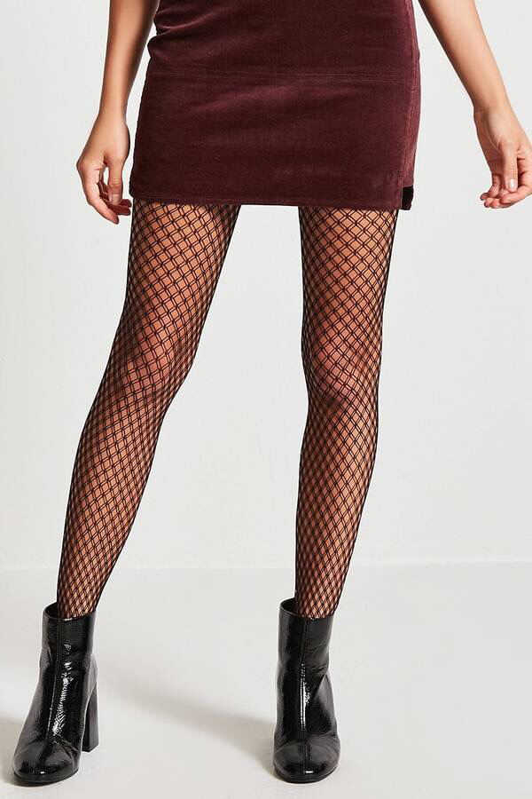 24bc77db6eb FOREVER 21 Geo Fishnet Tights A pair of sheer tights featuring a geo fishnet  design and an elasticized waist.